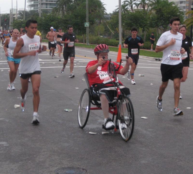 A Team Achilles athlete crosses the island.