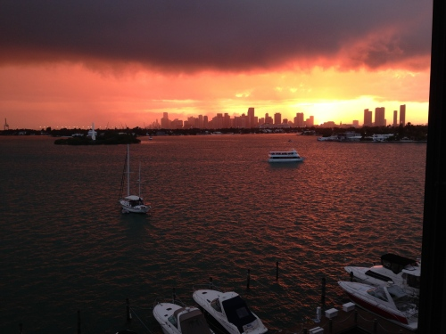 From Belle Isle, the sun sets of the city of Miami.
