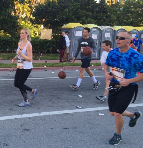 Darren Weissman, also known as Dr. Dribble, ran the whole race dribbling two basketballs.